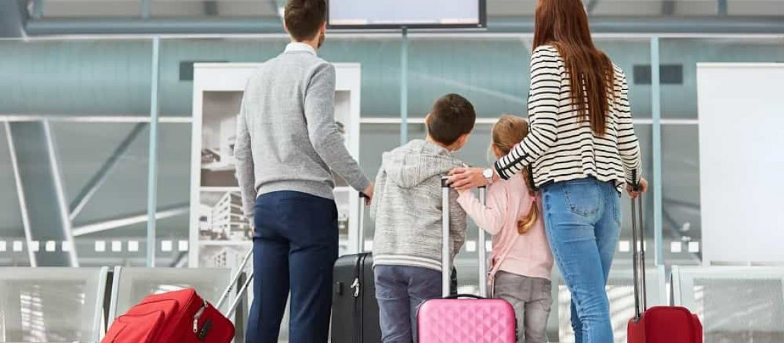 Family-looking-at-airport-departure-board.jpg